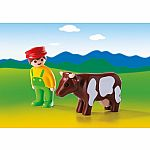 6972 - Farmer with Cow
