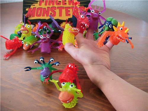 Finger Monster toys with their 80s packaging